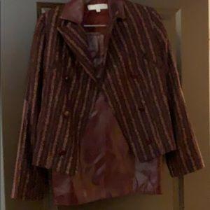 Carolina Herrera suit with leather skirt